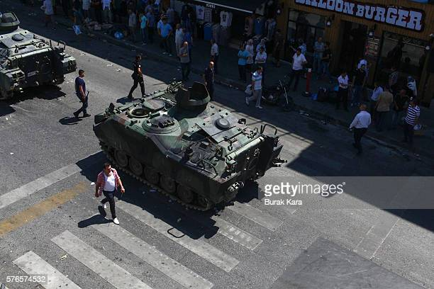 People walk past a Turkish army's abandoned tank in Uskudar district July 16 2016 in Istanbul Turkey Istanbul's bridges across the Bosphorus the...