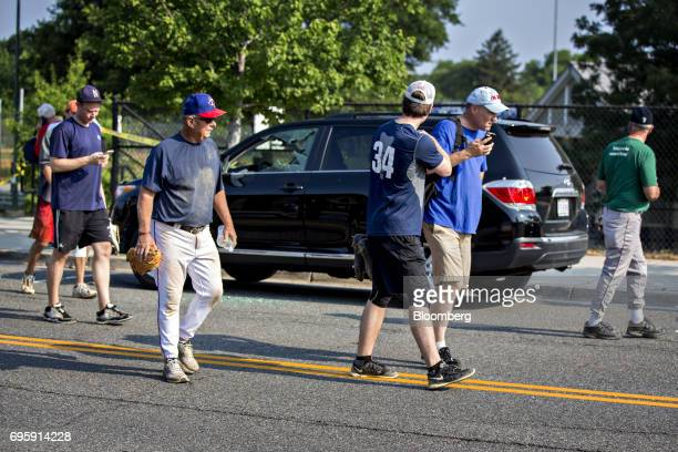 People walk past a vehicle with a damaged window near the Eugene Simpson Stadium Park in Alexandria Virginia US on Wednesday June 14 2017 The third...