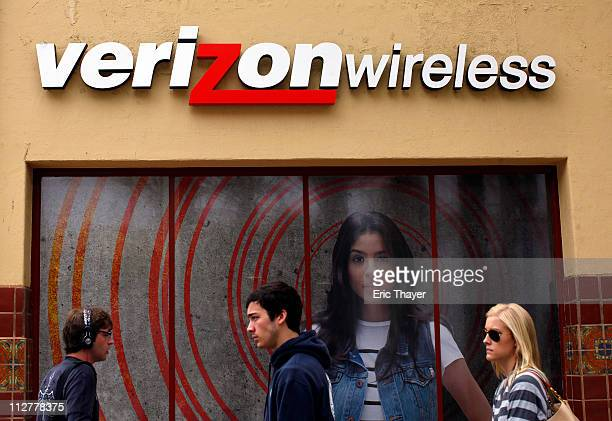 People walk past a Verizon store April 21 2011 in the Westwood neighborhood of Los Angeles California Verizon announced today that it activated 22...