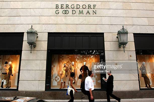 People walk past a window display at the luxury clothing store Bergdorf Goodman September 10, 2001 in New York City.