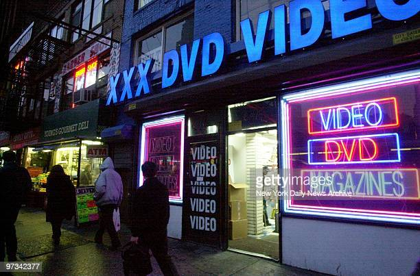 People walk past an adult video store on Eighth Ave in midtown Manhattan Since the US Supreme Court cleared the way for an enforcement crackdown in...