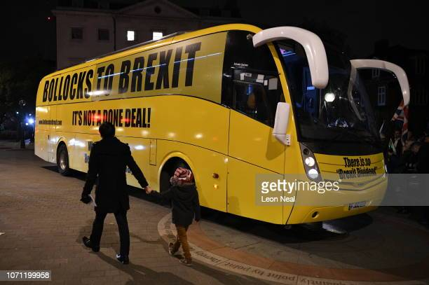 People walk past an anti brexit campaign bus parks outside the Houses of Parliament Westminster on December 10 2018 in London England The Government...