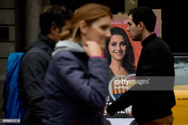 People walk past an election campaign poster of the candidate of the Ciutadans party Ines Arrimadas on 8 December 2017 in Barcelona Spain ahead of...