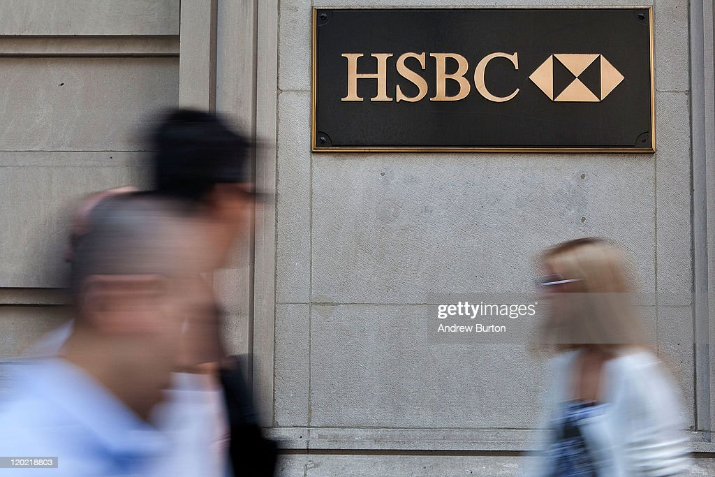 People walk past an HSBC Bank branch at 452 Fifth Avenue on August 1, 2011 in New York City. According to reports HSBC will eliminate 30,000 jobs worldwide and sell 195 branches, mostly in upstate New York, to First Niagara Financial for about $1 billion.