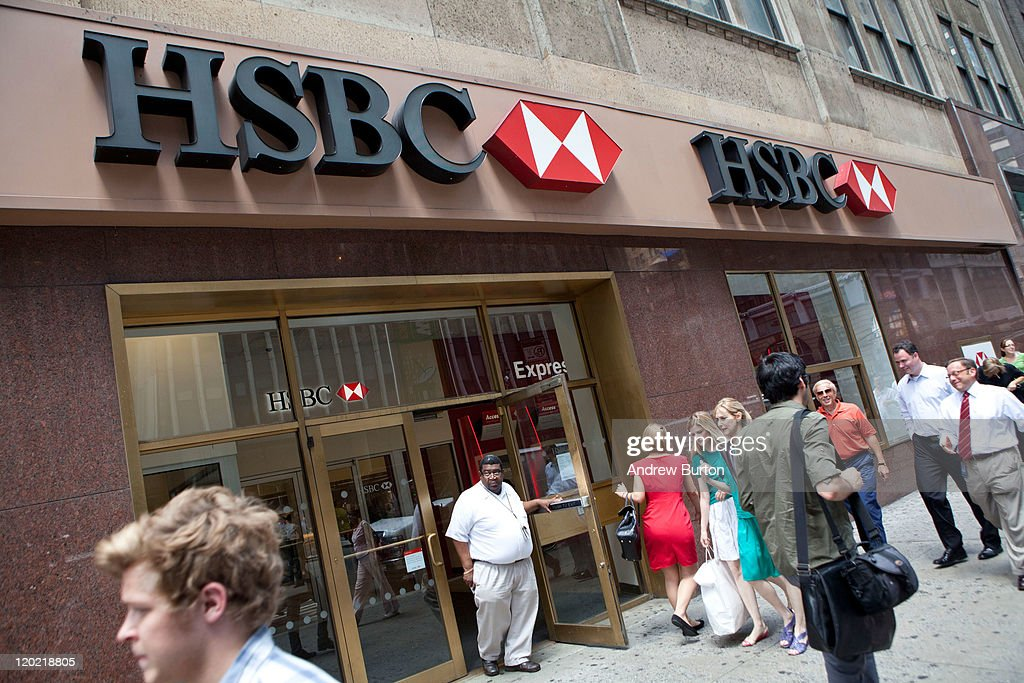 People walk past an HSBC Bank branch at 550 Fashion Avenue on August 1, 2011 in New York City. According to reports, HSBC will eliminate 30,000 jobs worldwide and sell 195 branches, mostly in upstate New York, to First Niagara Financial for about $1 billion.