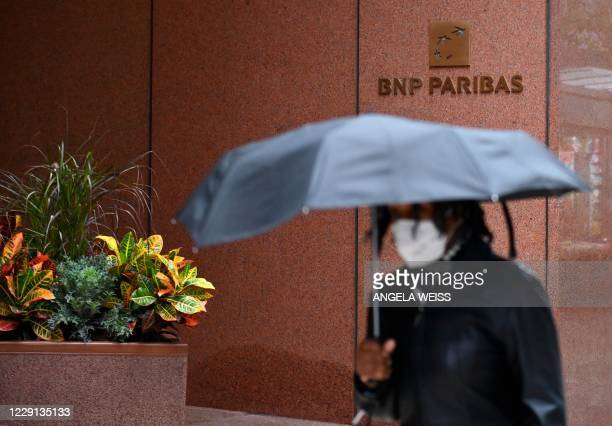 People walk past BNP Paribas, a french international banking group on October 13, 2020 in New York City. - The life of a Wall Street trader was once...