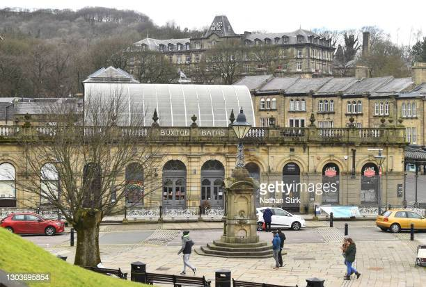 People walk past Buxton Baths on February 23, 2021 in Buxton, England.