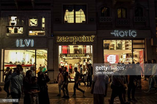 people walk past clothing stores on August 15 2018 in Istanbul Turkey The Turkish Lira recovered to trade at 61 USD despite President Erdogan...