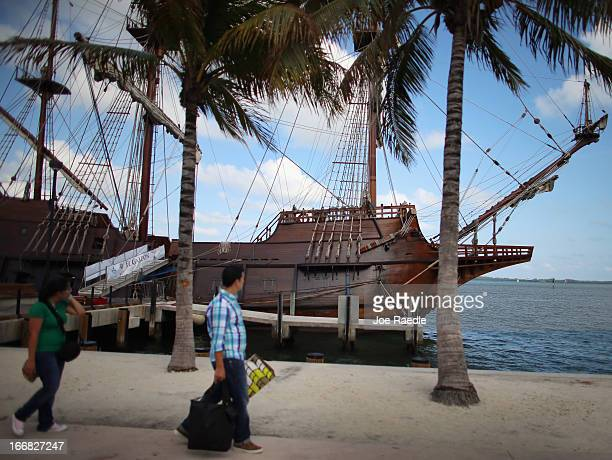 People walk past El Galeón a replica of a 16th century galleon during Florida's commemoration of the 500th anniversary of Spanish explorer Juan Ponce...