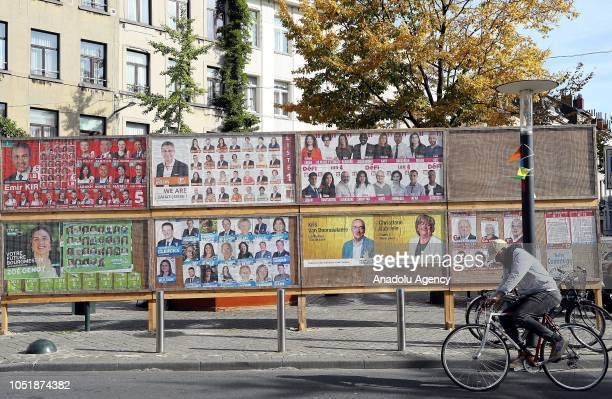 People walk past election campaign posters in Brussels Belgium 11 October 2018 Municipal elections will be held in the region on 14 October 2018