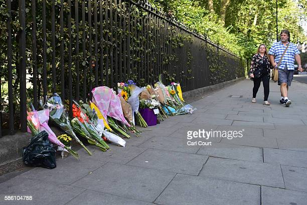 People walk past flowers laid at the scene of a stabbing in which one woman was murdered on August 5 2016 in London England Darlene Horton a...