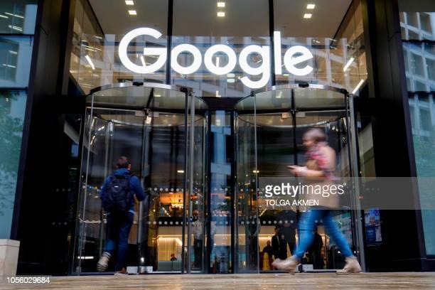 People walk past Google's UK headquarters in London on November 1 2018 Hundreds of employees walked out of Google's European headquarters in Dublin...