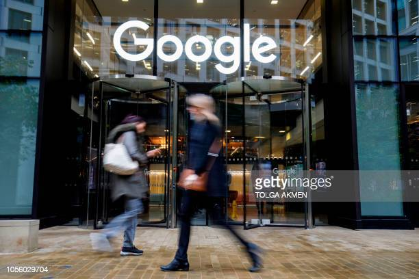 People walk past Google's UK headquarters in London on November 1, 2018. - Hundreds of employees walked out of Google's European headquarters in...