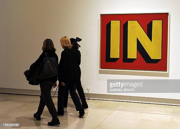 People walk past 'In' by US artist Roy Lichtenstein belonging to the Guggenheim foundation as part as an exhibition called 'Guggenheim Collection The...