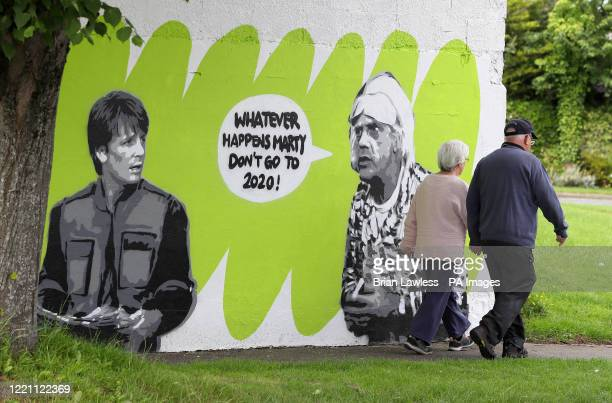 People walk past Irish artist Emmalene Blake's mural of characters Marty McFly and Doc Brown from the cult 80's movie 'Back to the Future' in South...