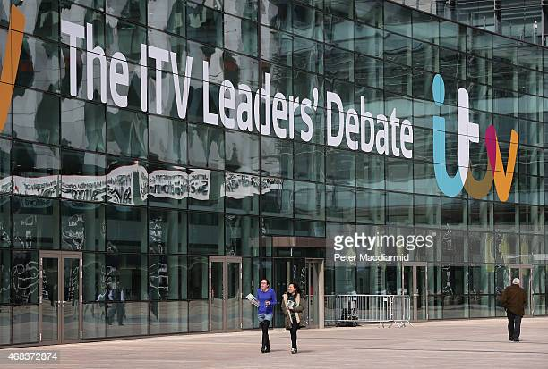 People walk past ITV studios where an election leaders debate will be broadcast later at Media City on April 2 2015 in Manchester England Tonight...