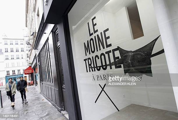 People walk past Le Moine Tricote a Paris store during the presentation of French designer Alice Lemoine's creations for the Fall/Winter 20122013...