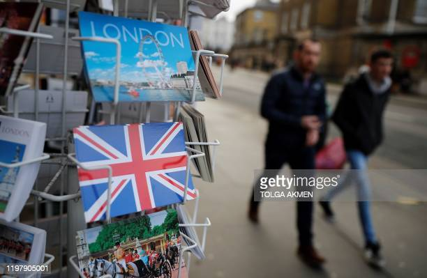 People walk past London-themed souvenirs and postcards in London on February 1 the day after Britain became the first country to formally leave the...