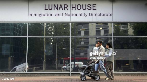 People walk past Lunar House the headquarters of Britain's Immigration and Nationality Directorate on October 4 2006 in Croydon England The IND is a...
