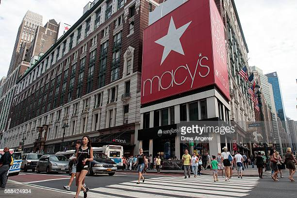 People walk past Macy's flagship store in Herald Square August 11 2016 in New York City On Thursday Macy's announced plans to close 100 stores...