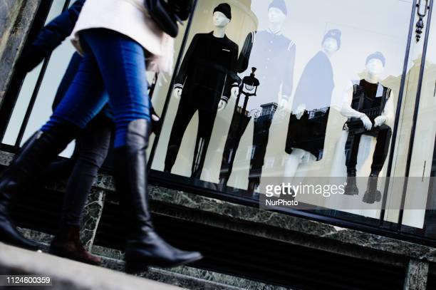 People walk past mannequins in the window of a clothing store on Conduit Street in London England on February 9 2019 February 15 sees the release of...