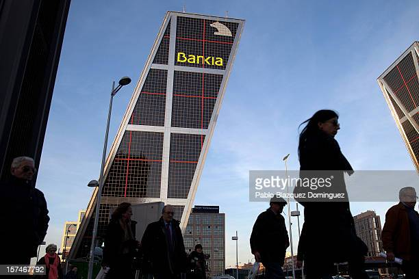 People walk past near the Bankia building at Plaza de Castilla on December 3 2012 in Madrid Spain Spain has formally requested 395 euro billions bank...
