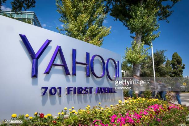 People walk past Oath Inc. Yahoo! signage displayed at the company's headquarters in Sunnyvale, California, U.S., on Tuesday, Aug. 28, 2018. Yahoo...