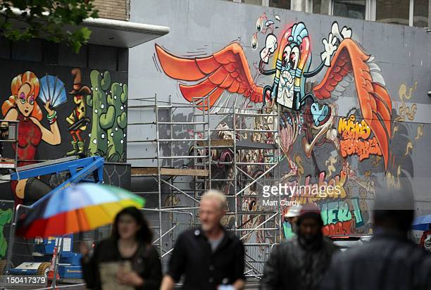 People walk past part of the 'See No Evil' street art project at Nelson Street on August 17 2012 in Bristol England The project now in its second...