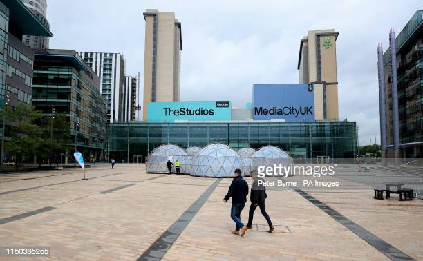 People walk past Pollution Pods installed by Cleanairgmcom at MediaCityUK in Manchester People can experience the air quality of cities across the...
