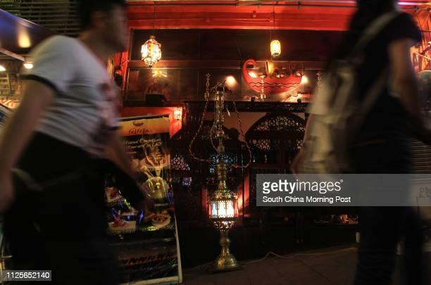 People walk past shisha bar Felfela in Lan Kwai Fong, Central. 21SEP11
