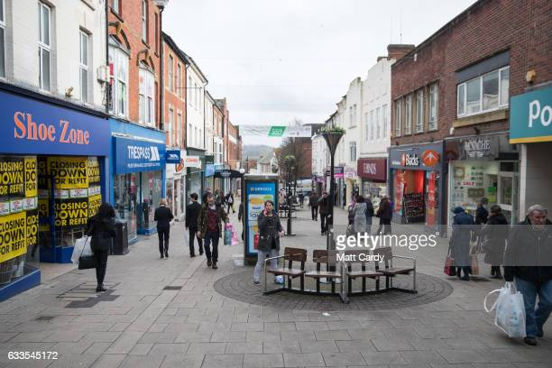 People walk past shops and retailers in the town centre of Yeovil on February 2 2017 in Somerset England Business rates which are based on the value...