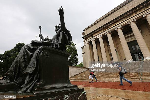 People walk past the Alma Mater statue on the Columbia University campus on July 1 2013 in New York City An interest rate hike kicks in today for...
