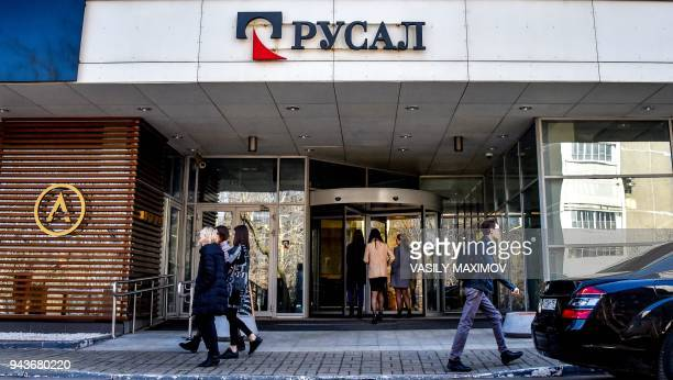 People walk past the aluminium giant United Company RUSAL headquarters in Moscow on April 9 2018 Shares in Russian aluminium giant Rusal collapsed on...