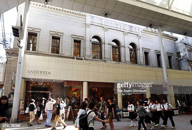People walk past the Andersen bakery Kyukan hall which exposed the Abomb on May 21 2015 in Hiroshima Japan