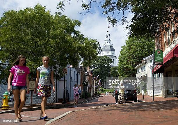 People walk past the Annapolis State House at the Annapolis Harbor MD August 22 2010 Annapolis was settled in 1649 and from 1783 to August 1784...