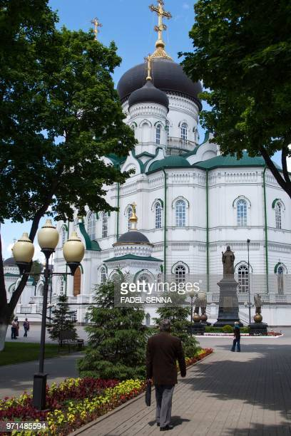 People walk past the Annunciation Orthodox Cathedral in the Russian city of Voronezh on June 11 three days ahead of the Russia 2018 World Cup...