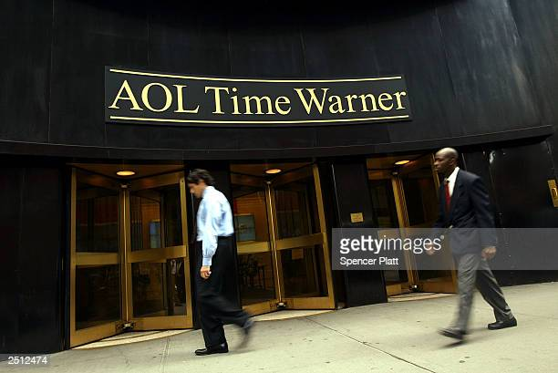 People walk past the AOL Time Warner headquarters September 19 2003 in New York City The board of AOL Time Warner on September 18 2003 voted to...