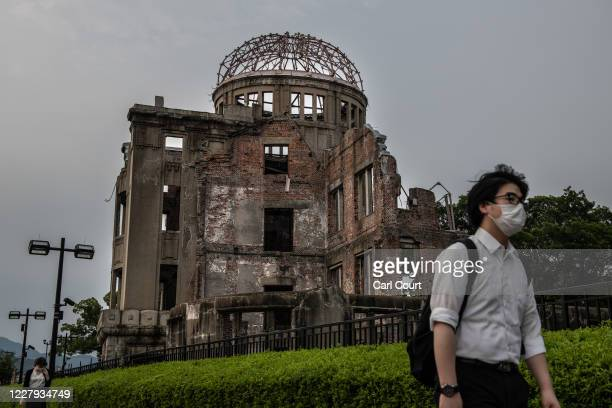 People walk past the Atomic Bomb Dome on the 75th anniversary of the Hiroshima atomic bombing, on August 6, 2020 in Hiroshima, Japan. In a ceremony...