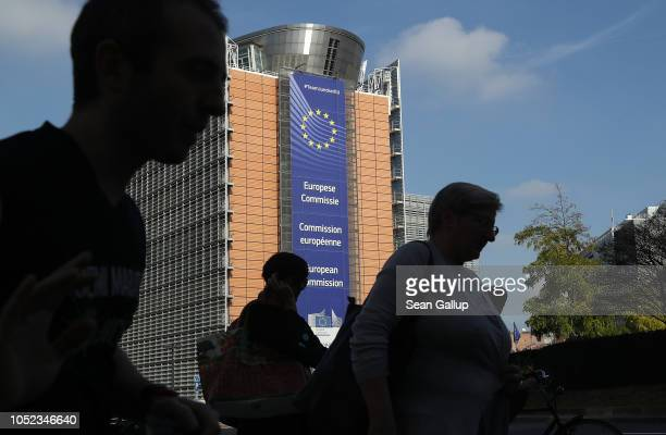 People walk past the Barleymont building of the European Commission on October 17, 2018 in Brussels, Belgium. British Prime Minister Theresa May is...