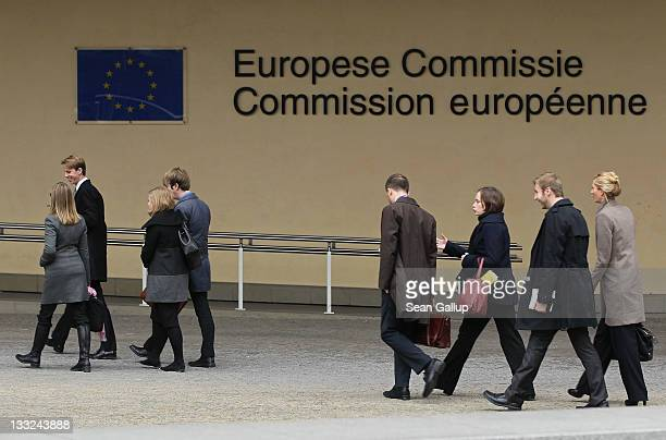 People walk past the Berlaymont building of the European Commission on November 17 2011 in Brussels Belgium Eurozone member countries are continuing...