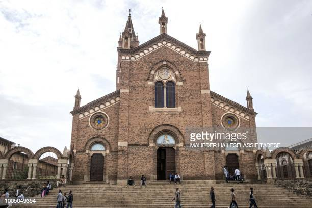 People walk past the catholic Church of our Lady of the Rosary in the Eritrean capital of Asmara on July 21 2018 Located at over 2000 metres above...