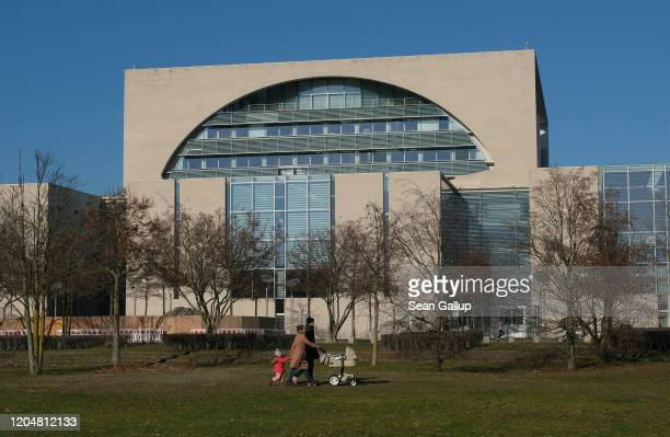 People walk past the Chancellery where the government coalition commission was meeting inside on February 08 2020 in Berlin Germany The coalition...