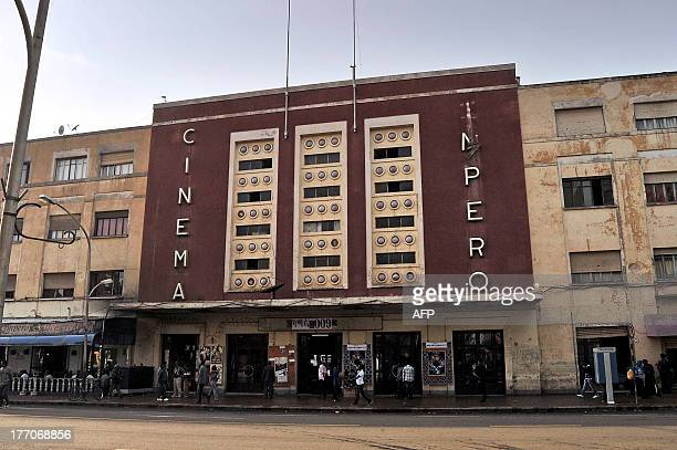 People walk past the Cinema Impero in Asmara, the capital of Eritrea, on July 18, 2013. Completed in 1937, it is one of several modernist-style...