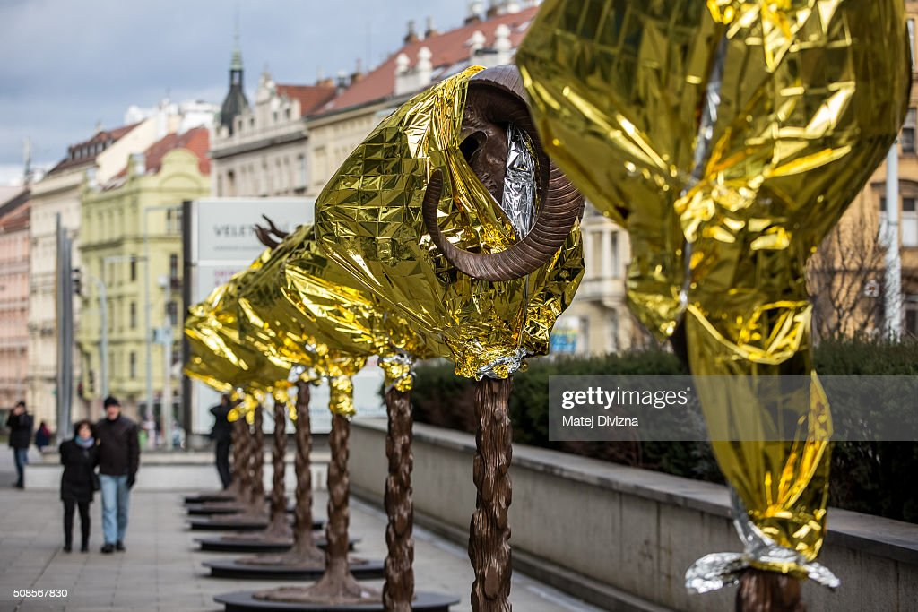 People walk past the 'Circle of Animals / Zodiac Heads' sculptures by Chinese artist Ai Weiwei in front of the Trade Fair Palace run by the National Gallery on February 5, 2016 in Prague, Czech Republic. An exhibition in front of the palace runs from February 6 to August 31, 2016. Ai Weiwei wrapped his bronze heads with thermal blankets to protest against migrants situation in Europe. It is the first time that the artist exhibits his work in the Czech Republic.