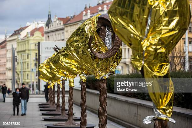 People walk past the 'Circle of Animals / Zodiac Heads' sculptures by Chinese artist Ai Weiwei in front of the Trade Fair Palace run by the National...
