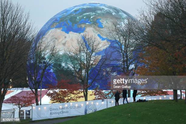 People walk past the 'Climate Planet' an exhibition and film venue sponsored by the German Federal Ministry of Economic Cooperation and Development...