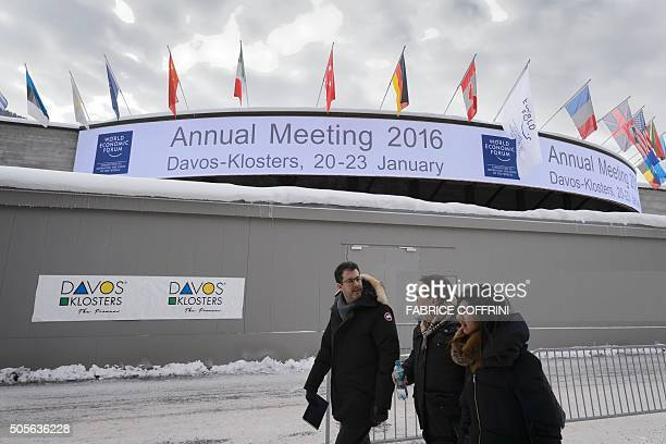 People walk past the Congress Center at the opening of the World Economic Forum annual meeting in Davos on January 19 2016 More than 40 heads of...