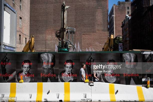 People walk past the construction site at 42 Crosby Street which is being developed into a luxury apartment building with 10 subterranean parking...