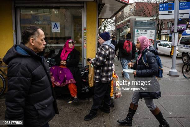 People walk past the corner of 74th Street and 37th Avenue Saturday December 15 in Jackson Heights New York It is considered one of the most diverse...