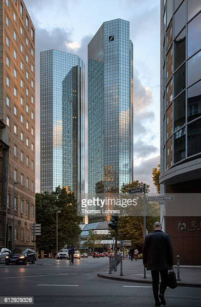 People walk past the corporate headquarters of Deutsche Bank on October 5 2016 in Frankfurt Germany Banks across Europe are struggling as their...